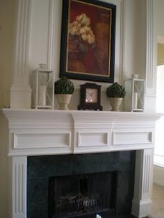 I like the look of this mantel.  It is warm and stylish.
