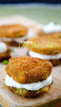 Fried zucchini chips served with a garlicky yogurt sauce. You can make zucchini canapes or even mini zucchini chip sandwiches with that yogurt sauce. | giverecipe.com | #zucchini #chips #snack #appetizer #zucchinirecipes #summerrecipes #partyfood #gamefood #sidedish
