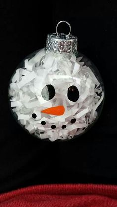 Snowman ornament - glass ball, white shred, glass paint. Good idea to shred paper to fill glass balls or block