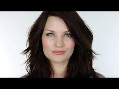 Dark hair, fair skin, blue eyes, pretty makeup