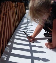 Keep kids busy - roll out a sheet of drawing paper and let them trace shadows!