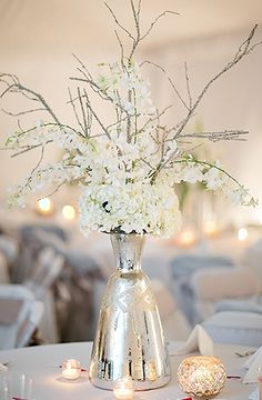 Metallic vases for centerpieces ... an eye-catching change of pace versus clear glass.