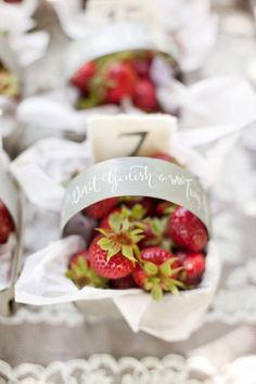 baskets full of strawberries used as escort cards  Photography by aarondelesie.com, Design   Planning by xoxobride.com