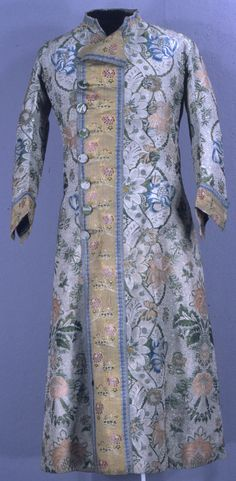 Man's dressing gown, Spain, mid-18th century. Heavy white silk brocaded with silk floss and chenille in a large-scale floral in blue, green and coral. The contrasting silk is a floral brocade with a yellow ground.