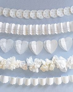 DIY Lace Garlands - Doilies and silk ribbons combine to make graceful garlands to be draped along reception tables. (from Martha Stewart)