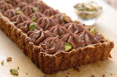 Gluten-Free Nut-Crusted Chocolate Mousse Tart - A decadent cream cheese chocolate mousse nestled in a rich pistachio crust.