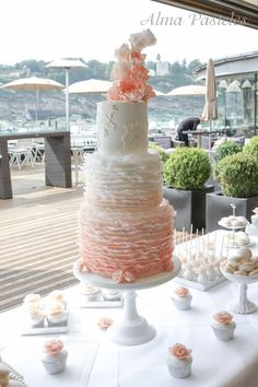 Ruffles and lace wedding cake wit sweet table
