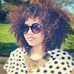 Click the image for Gabi's natural hair photos and regimen.