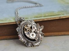 TIME TRAVELER, antique silver steampunk watch movement necklace with tiny dragonfly $36.50