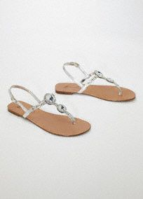 Comfortable and glamorous, this flip flop defines casual elegance. Jewel encrusted straps make this style shine. Metallic silver color is neutral and will look great with any outfit. Leather. insole. Imported. Available Online and in your Local Store.