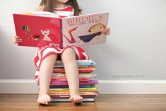 My kids both love books! This would be amazing to do! Or just use books as props in general!