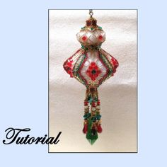 The Anastasia Christmas Ornament is a beautiful ornament accented by ribbons, netting, crystals and wonderful dangles. The pattern includes two color options, but this ornament is spectacular in any color.