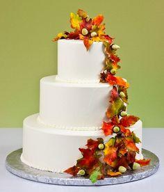 Classic white autumn themed wedding cake