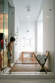 {Floor} Love the warmth of this #teak shower floor. #bathroomdesign