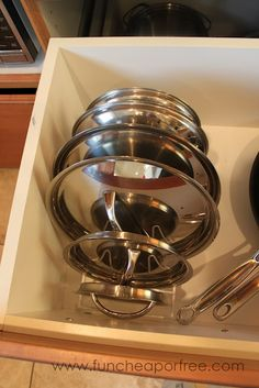 Use a cheap drying rack to organize your pot/pan lids. So doing this...
