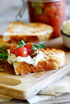 Marinated cherry tomatoes with whipped ricotta on sourdough.