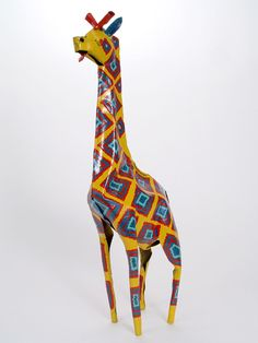 Large Tin Giraffe    $36.00. The giraffe is a graceful animal whose long neck represents the ability to be visionary while still viewing the past and present. As the tallest mammal in the world, the giraffe teaches us to increase our understanding by viewing life from all angles. The heart of the giraffe is large. In some African traditions, a giraffe symbol is taken to every meeting to assure that the understandings of the heart are addressed as well as the understandings of the head.