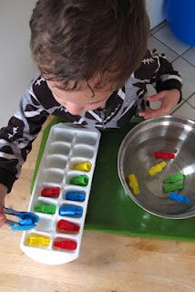Fine motor skills: removing items from water with tongs.