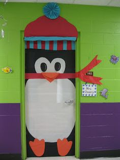 A penguin is a cute idea for a winter classroom door display and the colors in this one make it very eye-catching. (And oh what would I give to have aswesome hallway colors like that!!!)