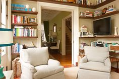 a library feel with floating shelves - could work for a large hallway, landing, etc.