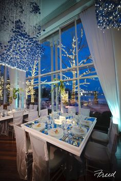 We are in LOVE with the unique chandeliers and gorgeous table setting of this modern and chic wedding reception at Sequoia Restaurant! {Sequoia Restaurant}