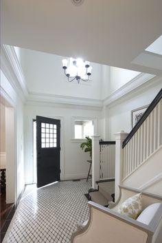 black front door; black & white stairs