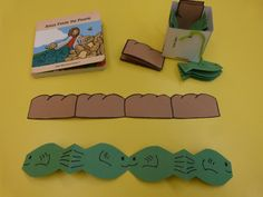 """Preschool Lesson: Jesus feeds the 5,000. Before class I made accordion fish and bread from paper (think paper dolls linked together by their hands). While telling the story, I would fold one of these up and show it to the children, then open it up and  explain how the food grew when Jesus prayed over it. I read the book """"Jesus Feeds the People,"""" pictured here. We also made paper baskets and each child got to take home an accordion fish and loaf in their basket."""