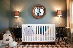 Adore this #houndstooth rug in this #mancave nursery - #babyboy #nursery