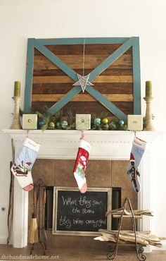 Barn Door Christmas Mantel. in LOVE with the colors and textures here.