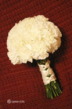 round white carnation bouquet! :hmmm just carnations... Now that's an idea. Add some navy blue and possibly a greyish color, and I'd be super happy.