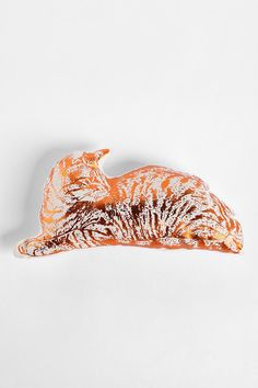 Pick up the 2012 edition of Threads Quick Stuff to Sew, and you can learn how to make a pet-shaped pillow like this one!