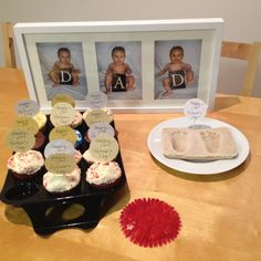 """First Father's Day morning surprise! 3 pictures spelling out DAD in an Ikea Ribba frame; cupcakes from his favorite cupcake place with """"Happy 1st Father's Day"""" tags that I made from left over scrapbook paper from the DAD letters (taped to toothpicks) and our son's feet prints (not yet painted). Success!"""