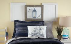 Create this shadow box custom headboard using plywood, rope lights, wainscoting and a picture frame. Dremel Weekends has the tutorial.