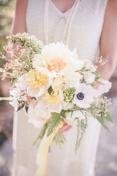 Beautiful Bouquet! But... we need identifying the large white blooms!! See the wedding on #SMP here: http://www.StyleMePretty.com/2014/04/16/great-gatsby-wedding-in-california/ Photography: ScottAndrewStudio.com    ShotgunFloralStudio.com