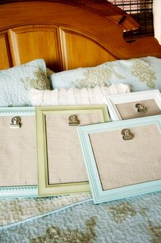 Painted frames with burlap and clip. Easily change out pictures. Cool for the hallway.