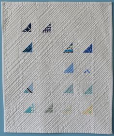 I am amazed by this.  First it appears random.. but look at the quilting.  The blue triangles actually line up.. how did she do this?    The Kansas City Modern Quilt Guild: Inspiration of the Week - atmosphere.