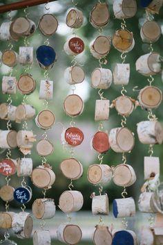 wood slice hanging escort cards, photo by Jordan Weiland http://ruffledblog.com/opulent-florida-wedding-inspiration #weddingideas #seatingcharts