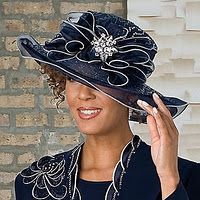 Brooch on hat.