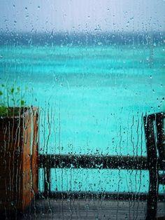 Maldives' rain on window pane by John Moguai