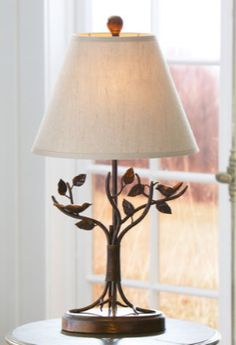 Our Aviary Table Lamp features a birds-on-branches motif.