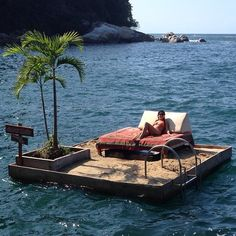 A really cool swim raft that looks like a tropical mini island. Stranded on an island....