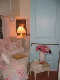 Camper interior with aqua and pinks...