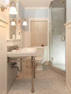 console sink, glass door shower, hex tile