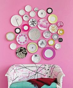 Flea market plates as a large-scale wall art installation.
