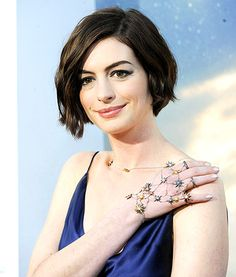 Out of this world! Anne Hathaway rocked some stunning star-embellished hand jewels to the world premiere of Interstellar,