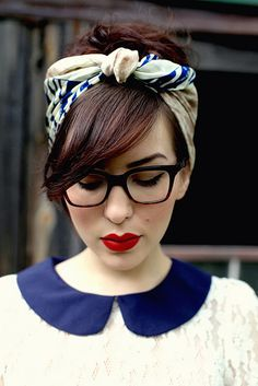 Hair scarf, glasses, red lips.
