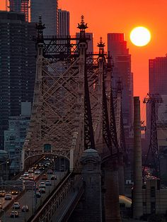 Big, bold sun sets by 59th Street Bridge on this sultry night, NYC