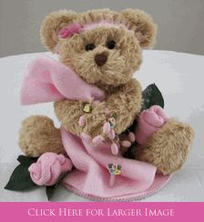 Baptism Balloon Centerpieces - Teddy Bear with Pink Porcelain Rosary Beads. Comes with French Lace Headband, Baby Sock Roses, Teddy Bear & Cross Table Sprinkles and Balloon Bouquet that attaches to Centerpiece from settocelebrate.com! Also available in Blue. #baptismgirls