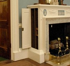 hidden staircase in a fireplace mantle