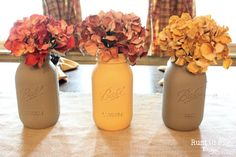 Painted mason jars and flowers with seasonal colors - to warm up the room!